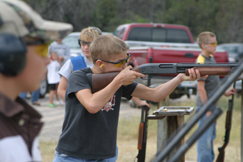 J.C. Henderson takes aim during Saturday's 4-H shooting sports competition at the Meeker Sportsman's Club. He placed first in junior shotgun. See Page 2A for shooting sports results.