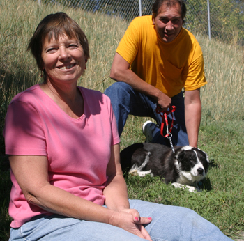"Susan Sammons, plant manager, and employee Glenn Abbott, who rescued Buddy, have ""adopted"" the dog as the plant's mascot."