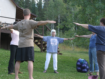 At the family's upriver ranch, Jean Welder teaches a group of yoga and tai chi students who will become teachers themselves.