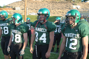 Rangely captains from left, Kindal Cushman, Cole Barlow, Adam Dahl and Patrick Phelan prepare to take the field prior to the start of Friday's home game against Aspen.