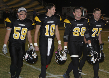 Meeker team captains, from left, Ever Olivas, Colton Brown, Tyrel Gerloff and Jarett Waldref take the field prior to the start of Friday's rivalry game against Rangely.