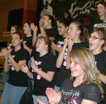 "Wearing ""Fight Like a Girl"" T-shirts to support Breast Cancer Awareness Month, this group of students was a vocal cheering section behind the Meeker volleyball team's bench."