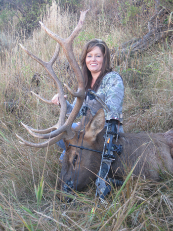 Beckey Dowker of Meeker with the 5x5 bull elk she shot Sept. 17 during a hunt with Joe Gutierrez, a guide with Strawberry Creek Outfitters.
