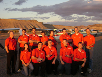 Members of CNCC flight team: Back from left, Jason Krueger (coach), Vince Campton, Ryan Stuhlmiller, George Davis, Jesse Krueger, Dan Hellewell, Shaun Lee and Derek Ward (coach). Front from left, Jennesse Forster, Tylor Yates, Marcus Kindall, Kyle Weinholdt and Eric