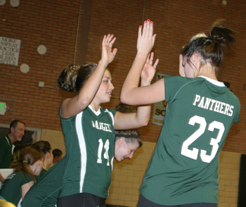 Rangely volleyball players Torie Slagle (14) and Dakota Kenney celebrate a point during Friday's rivalry match against Meeker. The Lady Panthers won in four games.