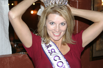 Roni Bibb of Meeker adjusts her Mrs. Colorado International crown at a surprise party thrown in her honor last week by family and friends.