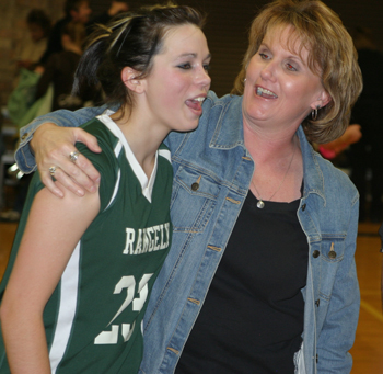 Rangelys Dakota Kenney is congratulated by assistant coach Betty Lopez after a win over Meeker in the district tournament.