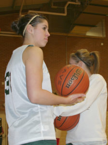 Rangely's Rozilynn Thacker, foreground, and Audrey Hogan warmed up before a scrimmage against Meeker on Nov. 21.