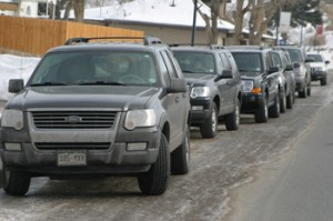 A line of dark-colored SUVs were parked in front of a residence on Main Street in Rangely last week as criminal investigation agents with the IRS were inside the house.