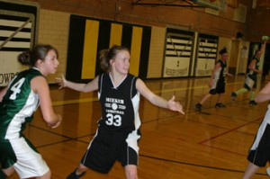 Meeker's Shelby Burke guards Rangely's Tessa Slagle during last Thursday's junior high game between county rivals.