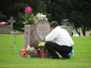 Joe Gutierrez visited the grave of his oldest daughter, Natasha, at Highland Cemetery on Memorial Day last year. Natasha died in 2005.