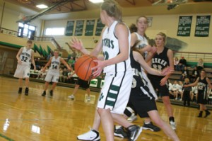 Rangely's Audrey Hogan looked to make a pass during Saturday's rivalry game against Meeker. In a battle for third place, Hogan scored a team-high 21 points and the Lady Panthers won 56-40.