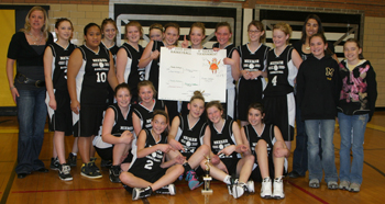 Members of Meekers eighth-grade basketball teams, along with head coach Deb Henderson, left, and assistant coach Nicole Dupire, right, posed for a group photo after winning the league tournament Saturday.