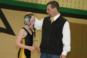 Meeker assistant coach J.C. Watt offered encouragement to Tristin Pelloni after the completion of his match last Thursday.