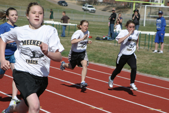 Barone Middle School seventh-graders, from left, Reagan Pearce, Paige Dowker and Alexis Lawrence competed for Meeker at the invitational track meet at Rangely.
