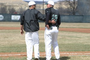 Rangely coach Paul Fortunato gives a pep talk to Kindal Cushman.