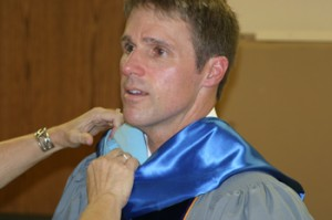 "Rangely Superintendent Barry Williams received a helping hand before Sunday's graduation. He congratulated the seniors on their ""great success."""