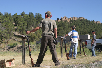Joe Newman, foreground, was first in shotgun for the junior division.