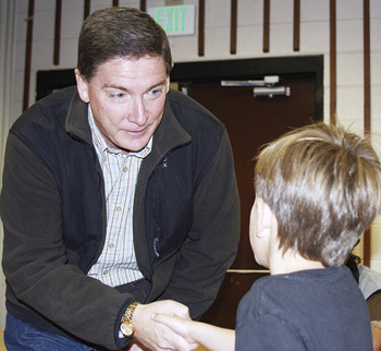 Republican gubernatorial candidate Dan Maes greeted Robbie LeFevre, 8, son of Doug and Lisa LeFevre of Rangely, after arriving for a campaign visit last Saturday at Colorado Northwestern Community College.