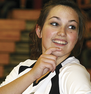 Meeker senior Laura Glass not only is a starter on the Lady Cowboy volleyball team but she also regularly sings the national anthem before sporting events, like she did before last Friday's Western Slope League match against Paonia.