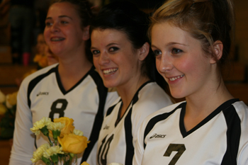 Meeker volleyball players honored their parents before the start of Saturday's home volleyball match and wore pink socks in recognition of breast cancer awareness month. Pictured from left: Kathryn Doll, Katie Morgan and Adrienne Wix.