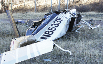 Investigators completed their scene investigation Friday up Wilson Creek, but it could be months before the cause of last week's helicopter crash is determined. Pilot Rich Westra was injured and his wife, Kelly, was killed.