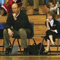 Meeker boys' basketball head coach Klark Kindler and his daughter Madison, watch the team warm up.