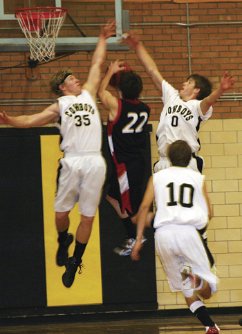 Meeker senior Ryan Wix (35) and junior Trey Morris (0) defend a shot against a Paonia Eagle. The Cowboys played tough defense to dominate the Eagles and win the game 55-35. The Cowboys also beat the Rangely Panthers by 20 (62-42) in a contest Tuesday in Meeker.