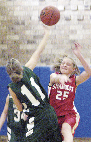 Rangely seventh-grader Jacy Rouse wins the tipoff against Steamboat. The RMS seventh-graders finished second.