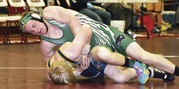 Senior Cole Barlow works to turn Brandon Morgan of Nucla in the semifinals at the regional tournament. Barlow was the only champ for the Panthers, winning the 152-bracket.