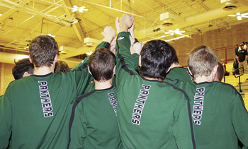 "The Rangely boys' basketball team put their hands together in solidarity before what became their final game of the season. Coach Hejl said his team worked all season on becoming a team and ""made huge strides in achieving that goal."""