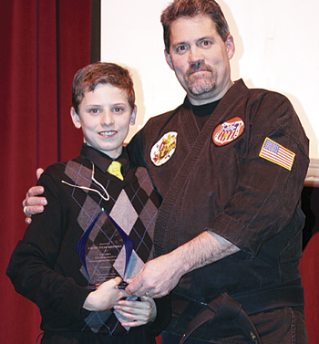 Ken Tork gave MHS freshman Ty Shepherd an award for his efforts to raise awareness of the choking game.