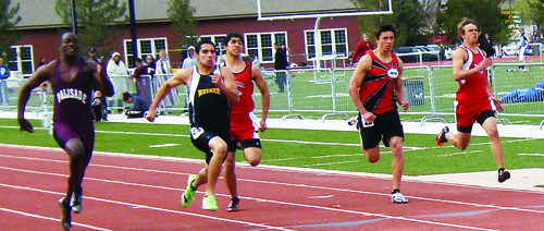 Cowboy junior Toby Casias had the fastest time in the 100- and 200-meter dashes, against runners from, Grand Junction, Fruita, Montrose, Glenwood Springs, Palisade, Delta, Olathe, Grand Valley, Rangely and other western slope teams, in the Frank Woodburn Invitational meet. Casias time in the 100, pre-qualified him for the state meet in Pueblo. Courtesy Photo.