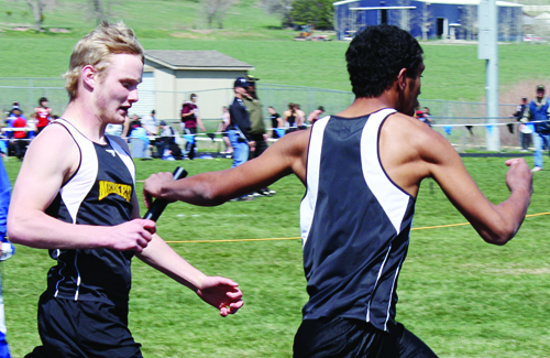 Meeker senior Jared Frantz hands off the baton to freshman Kevin Ely in the 4x200-meter relay, last Saturday in Glenwood Springs. The team, which also included speedster Toby Casias and Sebatian Clarke, finished fourth in the relay. Photo by Joan Overton