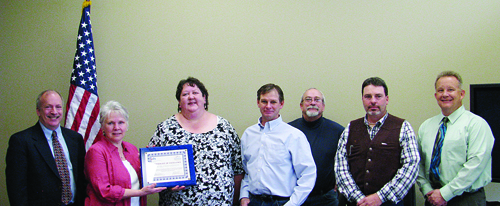 A certificate of excellence was presented to Andrea Harmon and the RBC Department of Social Services by John Bernhart (left), Director of the child support division of the Colorado Department of Human Services. Also pictured are Dana Giles, legal technician I - Rio Blanco child support enforcement, Andrea Harmon, child support enforcement administrator, Rio Blanco child support enforcement, RBC commissioners Kai Turner, Ken Parsons and Shawn Bolton, and Larry Desbien, chief of the policy and evaluation section for Colorado child support enforcement.