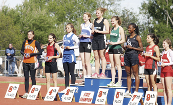 Meeker junior Kathryn Doll on the medal stand after winning the gold medal for the 2A state triple jump title last weekend in the 2011 Colorado State Track and Field Championships, in Denver. Doll improve on her runner-up finish in last year's state meet and medaled in two other events (long jump and 100) this year.
