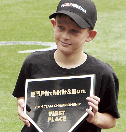 Chris Scherbarth holds the plaque he won in the Colorado Rockies Pitch, Hit and Run Team Championship competition at Coors Field last weekend.