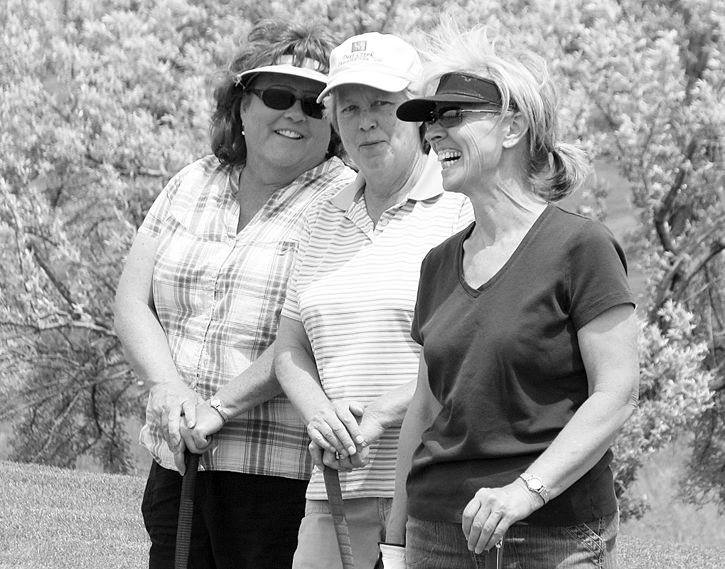 Linda Gordon, Deb Ely and Linda Birks, strategize while waiting to putt during the three-lady scramble scramble last Saturday, on a beautiful day at Cedar Ridges Golf Course. A four-man, 27-hole scramble, June 25, is the next tournament on the Cedar Ridges golf schedule.