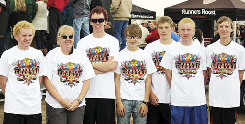 The Rangely High School boys cross country team and their coach Beth Scoggins (second from left) brought home Colorado State Cross Country Championship T-shirts and a third place team plaque for their school. Also pictured are Dale Neilsen, Coach Scoggins, William Scoggins, Marshall Way, Ethan Allred, Tanner Nielsen and Mitchell Webber.