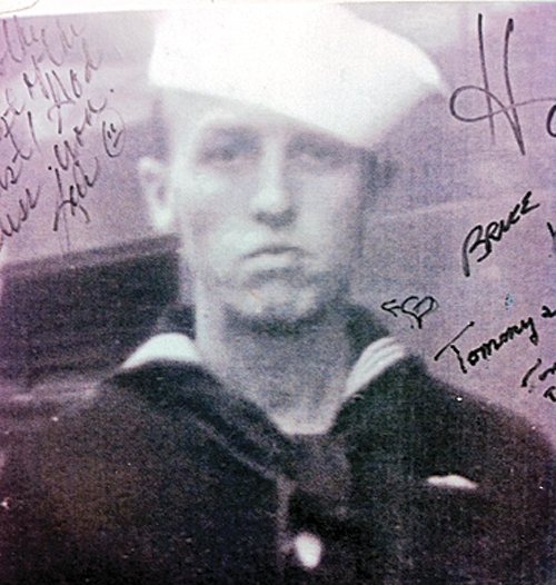 (Above) Archie Gregory in his Navy uniform. He was aboard the USS Arizona when it was bombed at Pearl Harbor. Today the ship is still visible underwater, and is the site of a memorial to those who died. (Below) Archie Gregory, 96, was among 24 survivors of the 1941 attack on Pearl Harbor who returned to the island for the 70th anniversary in December. Gregory attended school in Meeker from the age of 8 to 18. He currently lives in California with his daughter.
