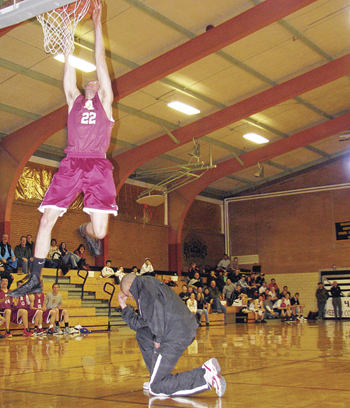 WREA Cowboy Shootout slam dunk champion Colin Cantwell of Shining Mountain jumped over one of his assistant coaches, Tebowing before a double hand slam which received three 10s from the judges.