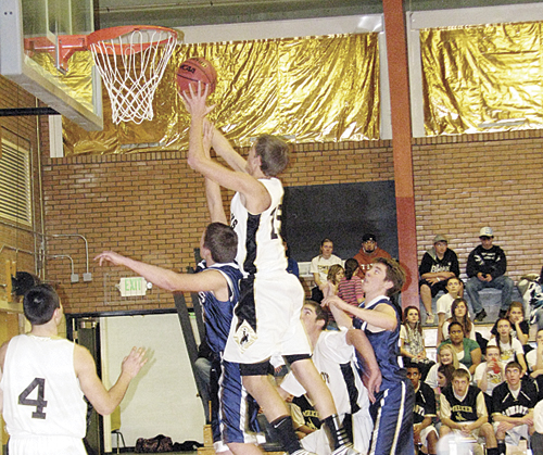Meeker Cowboy Gable Smith goes up for two points over a Vail Christian defender last Saturday in Meeker. The Cowboys won their first two games of the season with wins over Hayden and Vail Christian. Meeker will play two more league games this weekend, hosting the Plateau Valley Cowboys Friday and travel to Paonia Saturday.