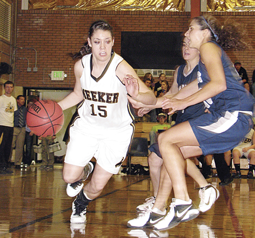 Meeker junior Kaysyn Chintala dribbles around two Vail Christian defenders in a league victory over the Saints last Saturday in Meeker. The lady Cowboys won their first league game of the season the previous night against Hayden, where Chintala led the team with six three-pointers.