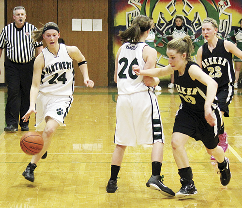 Rangely's Brittany Babineaux (20) sets a screen on Meeker's Aubrey Walsh, for her teammate Quincey Thacker (24) to dribble around. Babineaux and Thacker both scored 14 points against Meeker but lost the game 54-42.