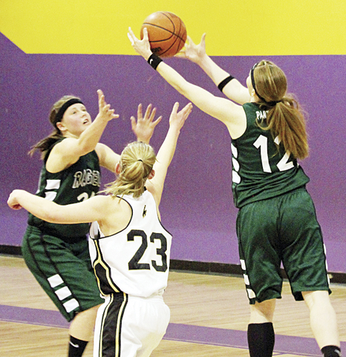 Rangely senior Haeley Enterline reaches out for a rebound over Meeker's Taylor Neilson, with teammate Brittany Babineaux also ready. The lady Panthers will play Lutheran in the District 4 regional tournament held at Metro State College this Friday, starting at 6 p.m.