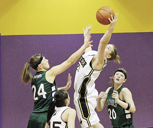 Meeker senior Kathryn Doll pulls in a rebound over Rangelys Quincey Thacker in the first round of the district tournament. Meeker beat Rangely but lost to Paonia in the championship game.