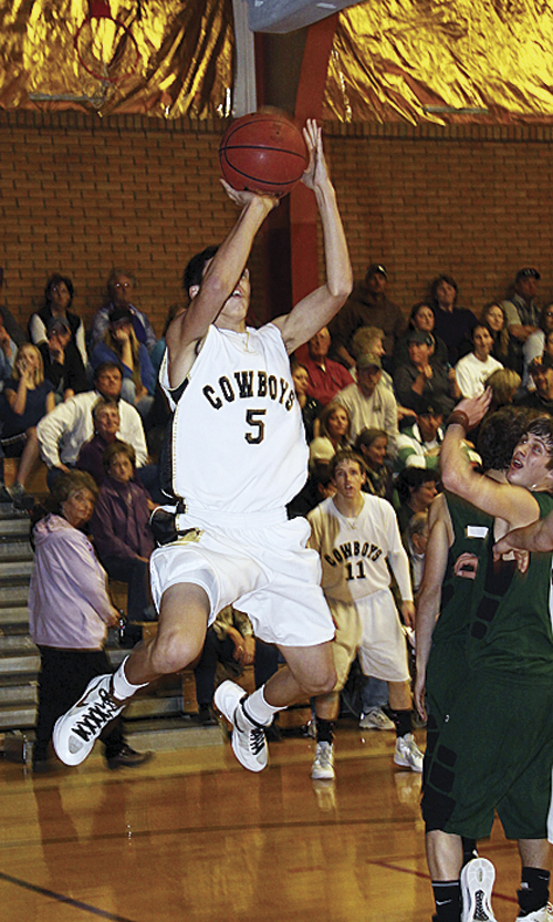 Meeker junior Jeremy Musgrave goes up for two of his five points against the Rangely Panthers. Musgrave and the Cowboys won the league and were given a first round bye in the district tournament. Meeker will play Paonia in the first round Friday at 7:30 p.m. in Kremmling.