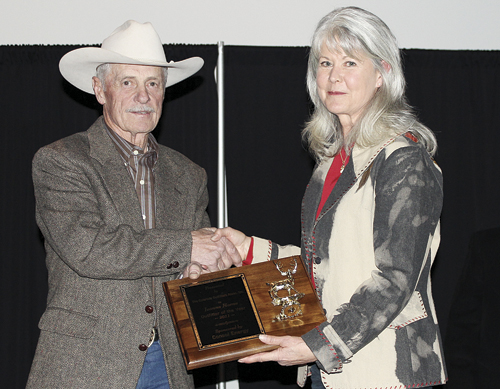 Jeanne Horne of Meeker receives the 2011 Outfitter of the Year award from the Colorado Outfitters Association president Dick Ray.