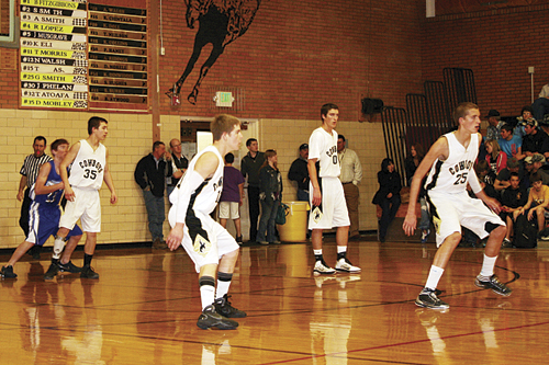 The Meeker boys' basketball team, including Dylan Mobley (35), Trey Morris (11), Cooper Smith (0) and Gable Smith (25), played tough defense, holding the DeBeque Dragons to 28 points, while offensively they scored 95.