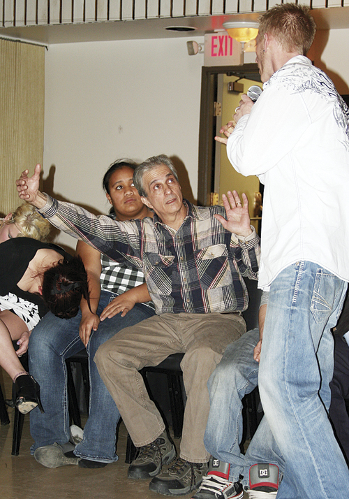 "Hypnotist Chris Mabrey hypnotized more than a dozen people but local restaurant owner Henry Arcolesse was the star of the show. Arcolesse kept seeing ""a big freakin' rat"" when Mabrey touched his forehead and he also got on stage and pretended to be exercise guru Richard Simmons."